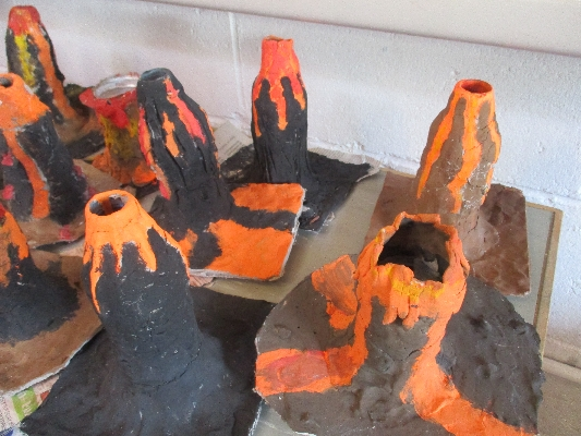 Volcanoes made from clay and painted